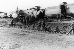 A damaged Polish armored train captured by German Leibstandarte SS Adolf Hitler regiment, near Blonie, Poland, Sep 1939