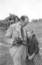 Photographer Julien Bryan comforting ten-year-old Polish girl Kazimiera Mika whose sister had just been killed by strafing German aircraft, near Jana Ostroroga Street, Warsaw, Poland, 13 Sep 1939