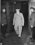 British Prime Minister Winston Churchill departing the conference room in Cecilienhof, Potsdam, Germany, 17 Jul 1945; note Soviet guards