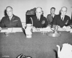 Brigadier General A. J. McFarland, Admiral William Leahy, and Admiral Ernest King at a meeting during the Potsdam Conference, Germay, 21 Jul 1945