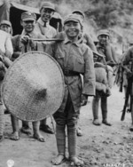 Chinese boy hired to assist troops of Chinese 39th Division during the Salween Offensive, Yunnan Province, China, 1944