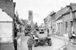 Canadian Daimler and Humber armored cars in the Belgian-Dutch border town of Putte, during the Anglo-Canadian drive to cut off the German 15th Army on the islands of the Scheldt Estuary, 11 Oct 1944