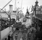 Oil being unloaded from the SS Fort Cataraqui in the Belgian port of Antwerp, 30 Nov 1944; this was the first ship to berth at the port following the opening of the Scheldt Estuary