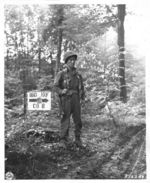 Japanese-American soldier of the 100th Infantry Battalion, 442nd Regiment, US 34th Infantry Division standing guard, near Chambois, France, 12 Oct 1944