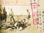 Japanese soldiers guarding a Chinese prisoner of war at bayonet point, south of Yuepu, Shanghai, China, Aug 1937; note Japanese censor