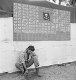 Tired member of US Navy VF-17 squadron paused under the squadron scoreboard at Bougainville, Solomon Islands, Feb 1944