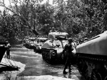 M4 Sherman tank and men of the US 1st Marine Division on the beach of Cape Gloucester, New Britain, Bismarck Archipelago, 15 Dec 1943