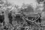 M4 Sherman tank and men of the US 1st Marine Division moving toward the airfield at Cape Gloucester, New Britain, Bismarck Archipelago, Dec 1943