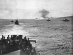 US Army LCI landing craft moving toward Cape Gloucester as smoke screened Target Hill and the beaches, New Britain, Dec 1943