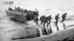 Men of US 3rd Marine Division disembarking onto the invasion beach at Bougainville, Solomon Islands, Nov 1943