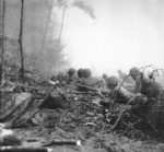 Men of the US 3rd Marine Regiment fighting just inland of Blue 3 Beach, Bougainville, Solomon Islands, 1 Nov 1943