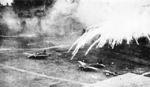 Phosphorus bombs exploding on Japanese airfields at Rabaul, New Britain, Nov 1943