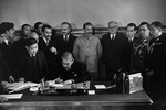 Japanese Foreign Minister Matsuoka signing the Soviet-Japanese Neutrality Pact, 13 Apr 1941, photo 1 of 3; note Molotov and Stalin in background