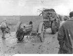 Spanish Nationalist field gun being towed by a truck, the Battle of Guadalajara, Spain, Mar 1937