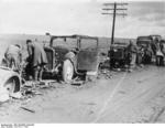 A column of vehicles destroyed by aircraft pushed to the side of a road, Battle of Guadalajara, Spain, Mar 1937