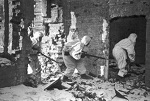 Soviet snipers moving amongst ruined buildings in Stalingrad, Russia, 1 Dec 1942
