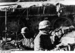 German troops in a foxhole covered by a wrecked T-34 tank, Stalingrad, Russia, 23 Sep 1942