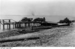 Vehicles on a ferry dock on the Volga River near Stalingrad, Russia, Aug 1942