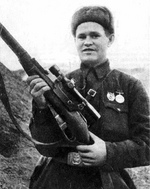Russian soldier Vasily Zaytsev posing with his Mosin-Nagant sniper rifle, Stalingrad, Russia, Oct 1942