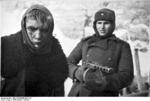 Russian soldier with PPSh-41 submachine gun guarding a wounded young German prisoner of war, Stalingrad, Russia, Jan 1943