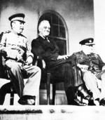 Stalin, Roosevelt, and Churchill on the portico of the Russian Embassy during the Tehran Conference, 29 Nov 1943, photo 2 of 2
