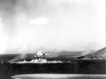 Japanese ammunition ships in Truk Harbor destroyed by dive bombers of USS Intrepid, Caroline Islands, 17 Feb 1944, photo 1 of 2; the dive bomber that caused this destruction was also lost in the blast
