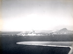 Japanese ammunition ships in Truk Harbor destroyed by dive bombers of USS Intrepid, Caroline Islands, 17 Feb 1944, photo 2 of 2; the dive bomber that caused this destruction was also lost in the blast