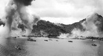 Japanese naval base, warships, and fishing boats at Dublon Island under American aerial attack, Truk Atoll, Caroline Islands, 16 Feb 1944, photo 1 of 2