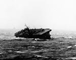 USS Langley in heavy seas in the South China Sea in the morning of 13 Jan 1945. Note the trailing USS Washington riding the storm much better.