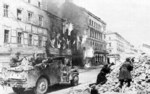 Soviet troops in US-built M3A1 scout car fighting in Vienna, Austria, Apr 1945