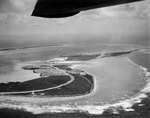 Aerial photograph of Wake taken from a PBY Catalina on 25 May 1941, looking west along the northern side, with Peale Island in the center and Wilkes Island in the left distance