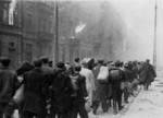Jews being marched to the Umschlagplatz rail station for deportation, Warsaw, Poland, Apr-May 1943