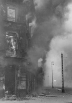 Burning residential building at the intersection of Zamenhofa and Wolynska Streets in Warsaw, Poland, Apr-May 1943
