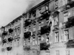 Jewish man committing suicide by jumping off the top story window of the building at 23 and 25 Niska Street during the Warsaw Ghetto Uprising, Poland, Apr-May 1943, photo 1 of 2