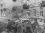 Jewish man committing suicide by jumping off the top story window of the building at 23 and 25 Niska Street during the Warsaw Ghetto Uprising, Poland, Apr-May 1943, photo 2 of 2