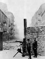 German troops with MG 08 heavy machine gun near the intersection of  Nowolipie and Smocza Streets in Warsaw, Poland during the Warsaw Ghetto Uprising, 1943
