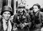 Young Polish resistance fighters in Warsaw, Poland, early morning of 2 Sep 1944, photo 1 of 2; the boy with helmet was identified as Tadeusz Rajszczak