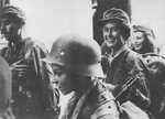Young Polish resistance fighters in Warsaw, Poland, early morning of 2 Sep 1944, photo 2 of 2; the boy with helmet was identified as Tadeusz Rajszczak