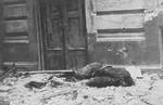 Remains of a German soldier killed during the Warsaw Uprising, Poland, 23 Aug 1944
