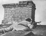 Polish insurgent fighter positioning himself on a roof, Evangelic Cemetery, Warsaw, Poland, 2 Aug 1944