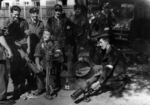 Polish fighters Andrzej Maringe, Stanislaw Potworowski, and others of Battalion Czata 49 with PIAT launchers, Aug 1944