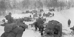 Russian T-26 light tanks and T-20 Komsomolets armored tractors advancing into Finland during the Winter War, 2 Dec 1939