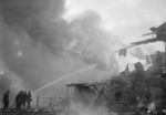 Firefighters attempting to control fires caused by Soviet bombing, Finland, late 1939-early 1940