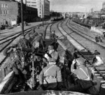 Finnish troops posing with anti-aircraft machine guns at a railyard in Helsinki, Finland, 13 Oct 1939