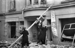 Finnish civilians escaping from a building damaged by aerial bombing, Lönnrothkatu Street, Helsinki, Finland, 30 Nov 1939