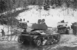 T-26 light tanks and GAZ-A trucks of Soviet 7th Army, Finland, 2 Dec 1939