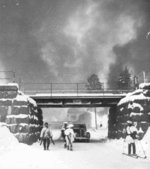 Finnish troops leaving Suojärvi, Finland, 2 Dec 1939; note smoke rising from the sabotaged equipment