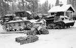 Wrecked Soviet T-26 tank and T-20 Komsomolets tractor, Finland, 1939-1940