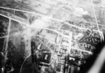 Heito Airfield under attack by aircraft of squadron VB-80 from USS Ticonderoga, southern Taiwan, 9 Jan 1945, photo 1 of 3