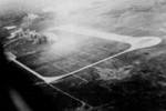 Heito Airfield under attack by aircraft of squadron VB-80 from USS Ticonderoga, southern Taiwan, 9 Jan 1945, photo 2 of 3